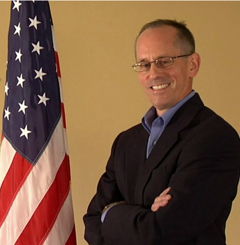 jeff kortes smiles with flag